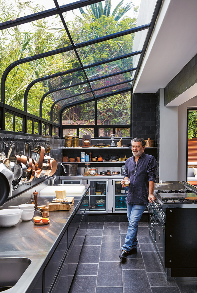 The conservatory-style windows in the kitchen were made in a collaboration between Glass Benders and Metal Windows.