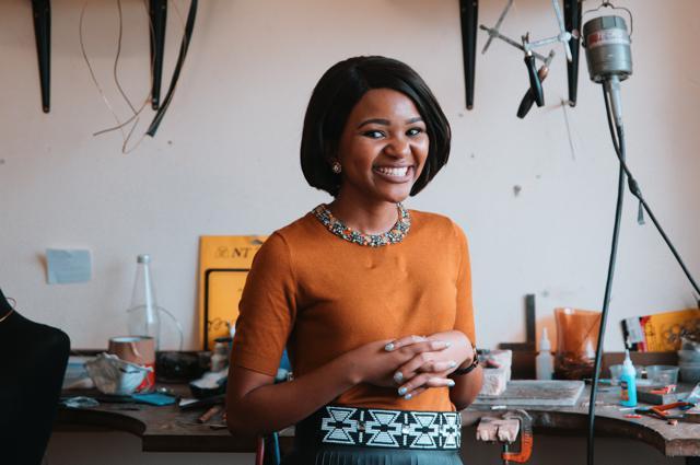 Zoe Msutwana wearing a belt from Lashongwe.