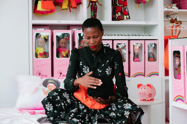 Kwena Baloyi with one of the dolls from the Sibahle Collection.