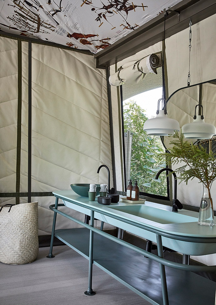 The tent walls were padded and quilted in a sandy-toned canvas to match the natural light-coloured sand found in the area. The goal was to keep the tents light and airy and also capture the romance of luxury camping by being reminiscent of old safari tents, which were white cotton canvas.