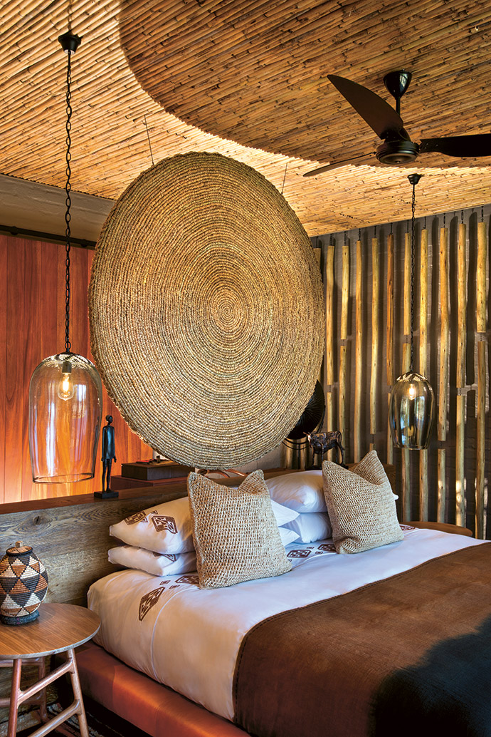 A showstopping suspended circular headboard pays homage to both the circular memory pond and the sheer artistry of local artisans' work. Sleek timber elements are juxtaposed with the latte ceiling and wall cladding.