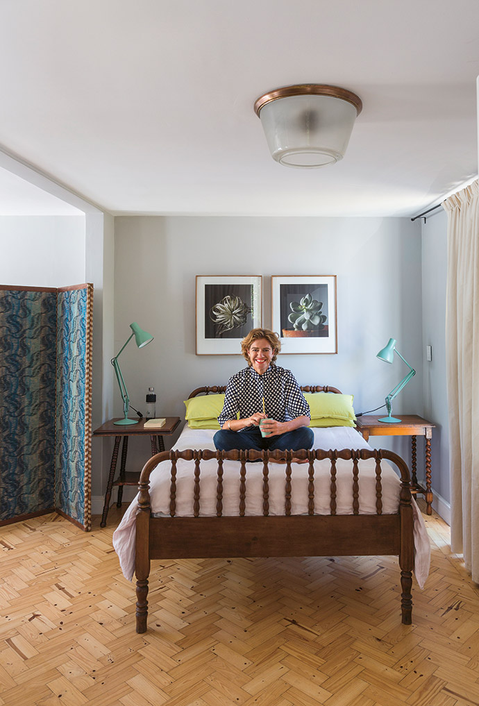 An antique tolletjie bed offers Tasha a luxurious perch from which to survey her compact kingdom. The plant portraits above the bed are from a photographic series of succulents by Jac de Villiers, called Vetplant.