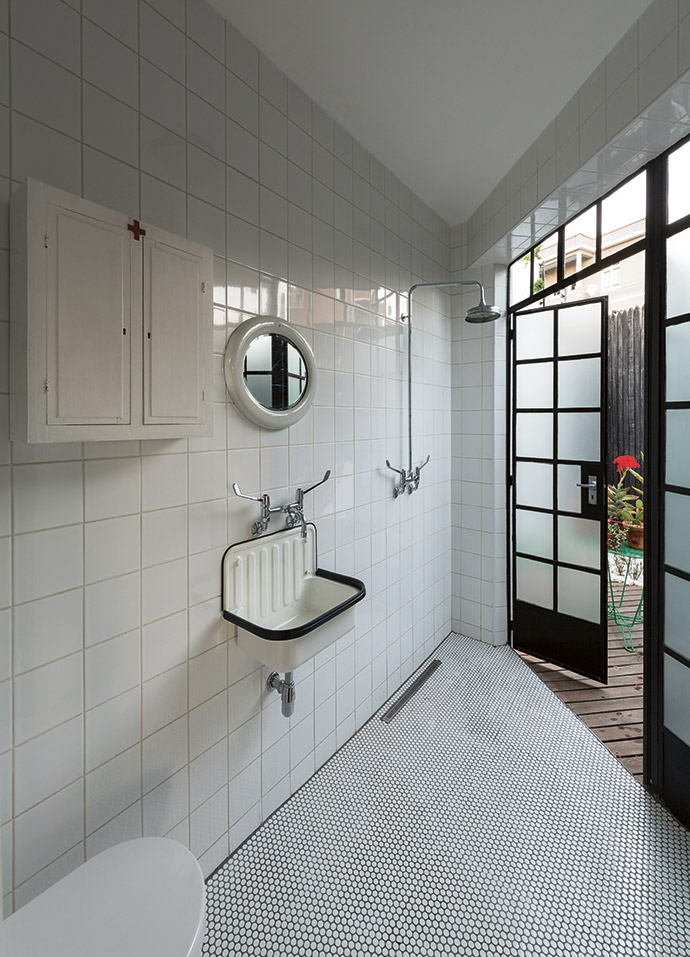 Quirky and clean-cut, the triangular bathroom is a study in space economy. The wall-mounted basin is from Flush Bathrooms.