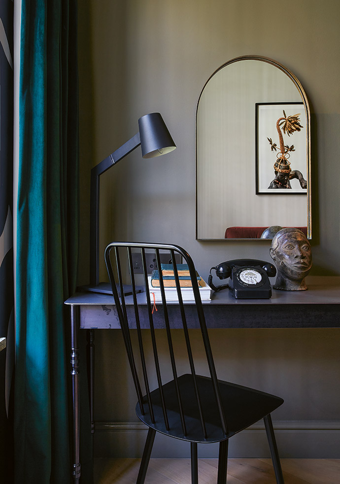A Gregor Jenkin desk in every room gives you a minute to gather your thoughts and reflect on the day. The reflected artwork is from the African Twilight series by Carol Beckwith and Angela Fisher, from THK Gallery.