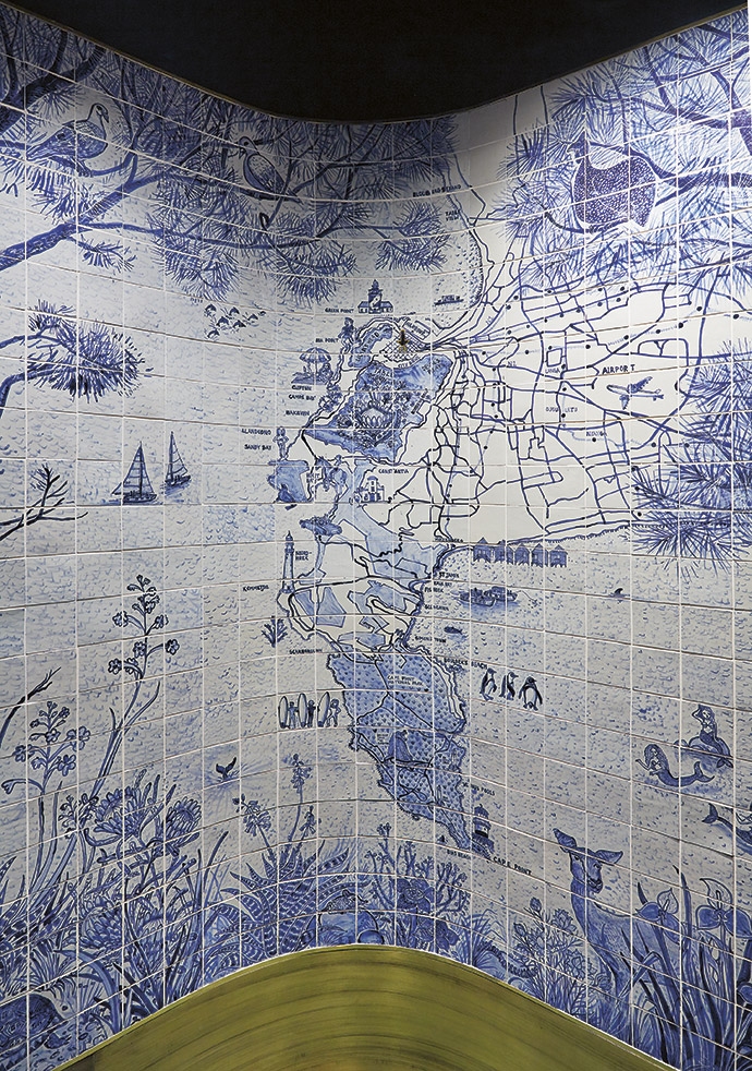 """Artist Lucie de Moyencourt painted this tile wall and a map of the Cape Peninsula in the hotel lobby, and the tabletops in the restaurant. """"My work comes from a happy place,"""" she says. """"It's all about spreading beauty and joy, and rooting the viewer in a specific place."""""""