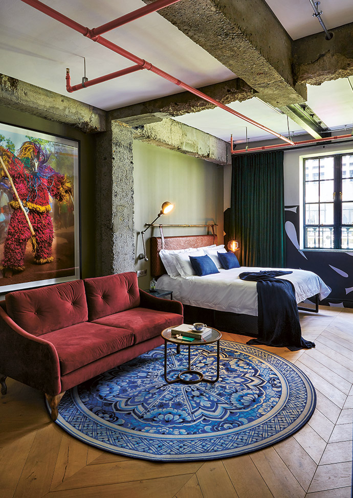 In this studio room, the artwork, from THK Gallery, is a print from the African Twilight photographic series by Carol Beckwith and Angela Fisher. On the Moooi carpet is a table by Studio 19.