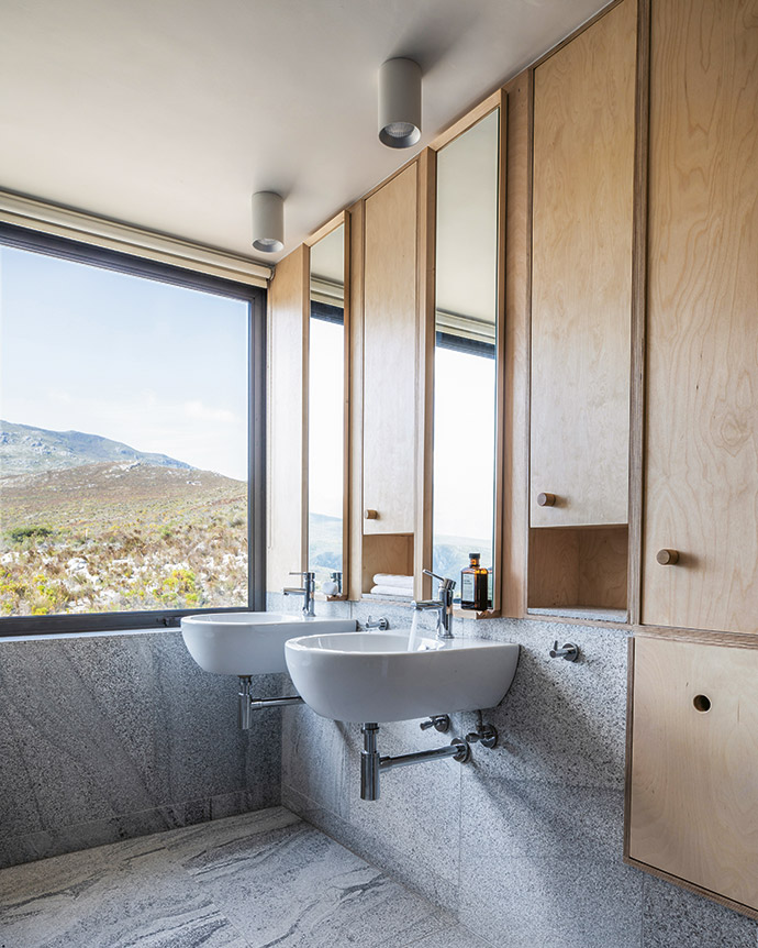 In the bathrooms, practical stone tiles are juxtaposed with light birch.